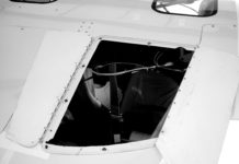 Split wing fold hatch provides exit for recovery chute.