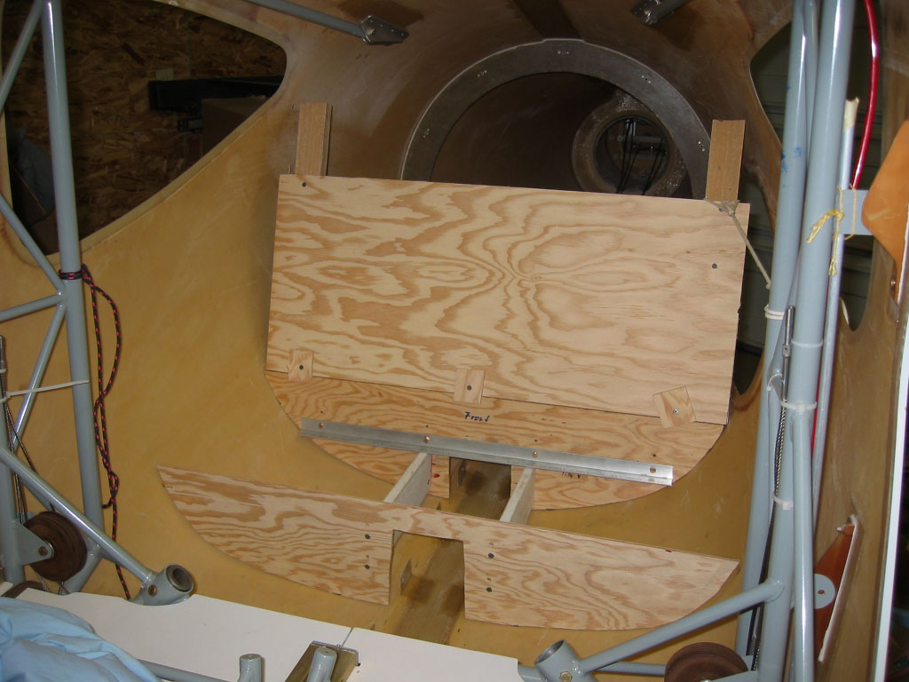 First, a template was made from plywood to determine the best tradeoff between leg and headroom. The seatback will eventually fold forward to make room for bulky items.