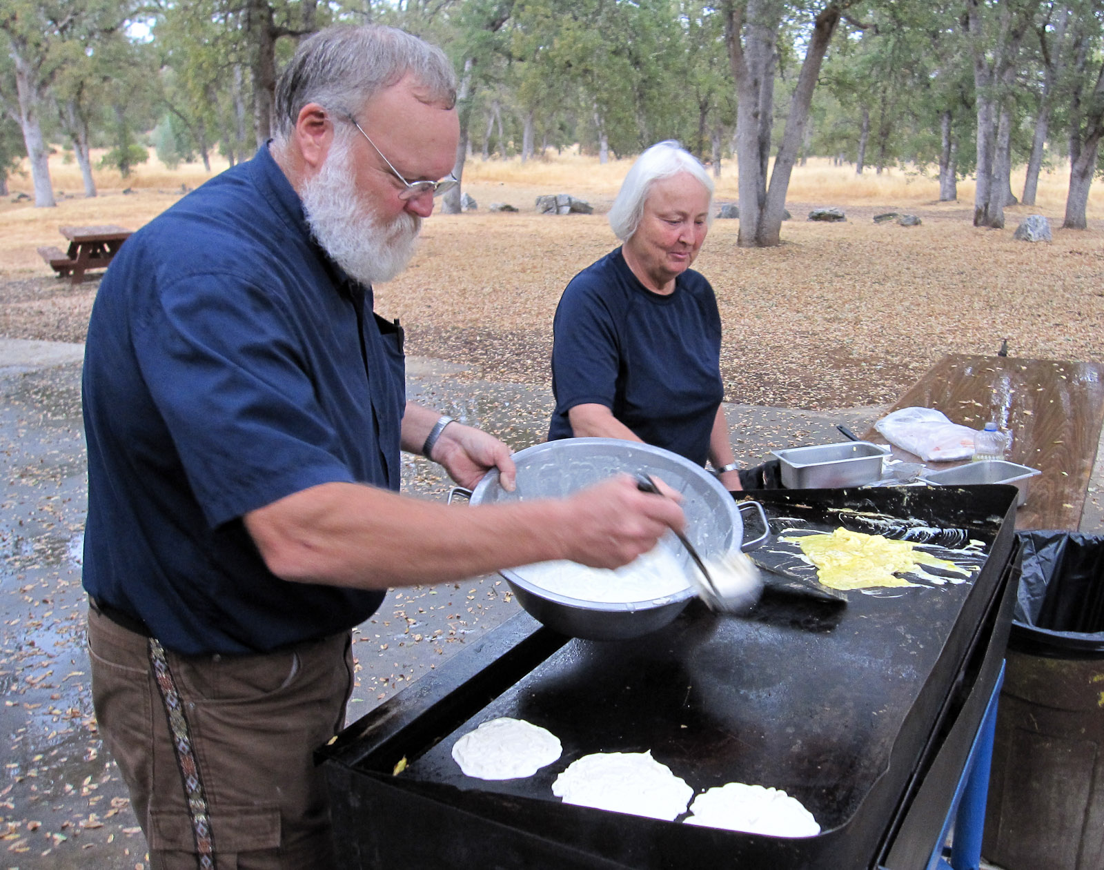 Charlie and Margaret Burton grill up a tasty breakfast of eggs and potato pancakes. Photo: Ann Walker.