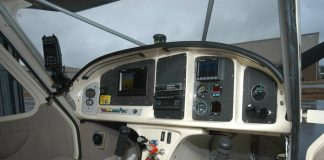 Low corners on the sides of the instrument panel enhance visibility, but the center column could impede access and reduce leg comfort. Photo: Peter Braswell.