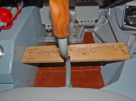 Rigging jig used to hold the right control stick in a vertical orientation.
