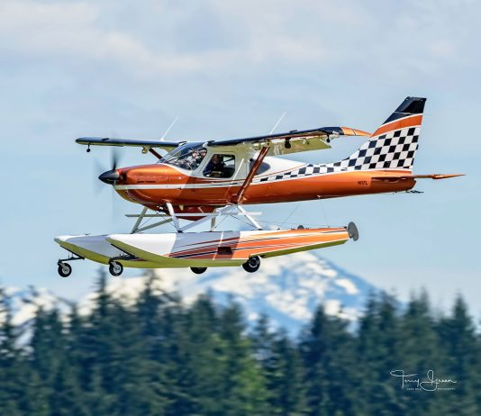 Steve Brault's Sportsman landing at Arlington Municipal. Photo by Terry Green/Hawg Wild Photography.