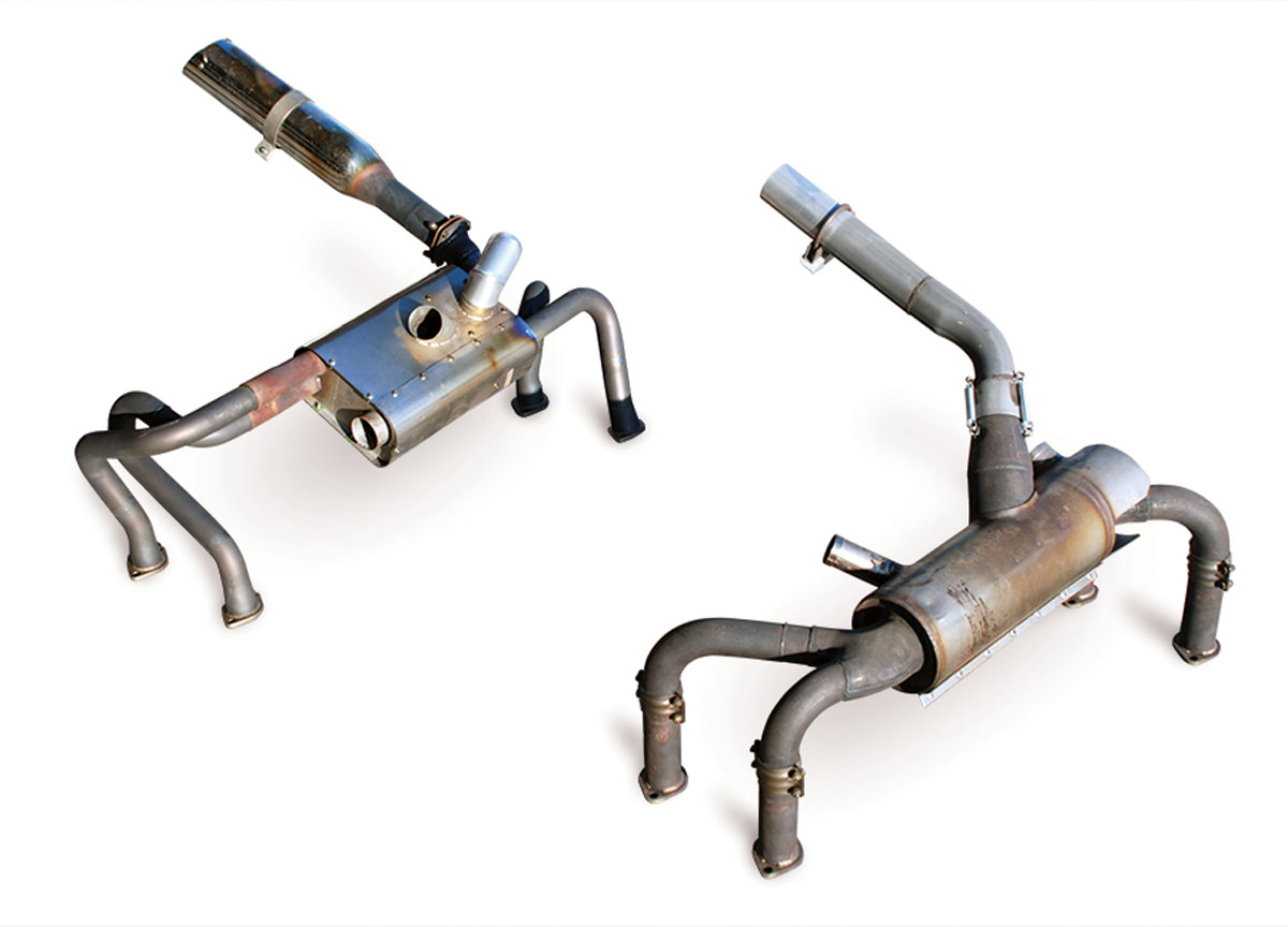 The Power Flow system (left) has a much larger final exhaust pipe and a smaller heater muff compared to the standard system (right).