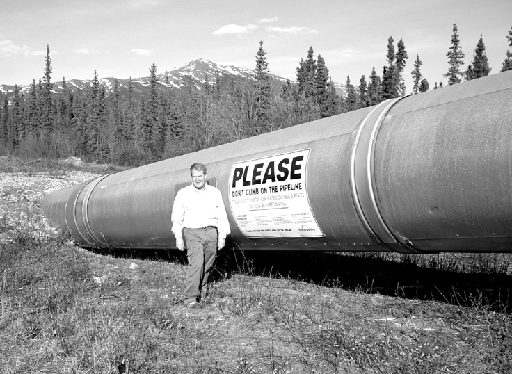 Jeff Mitchell next to the TransAlaska Pipeline near Coldfoot