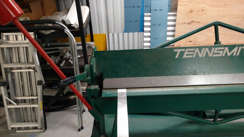 Practicing bending a test piece in the sheet metal brake.