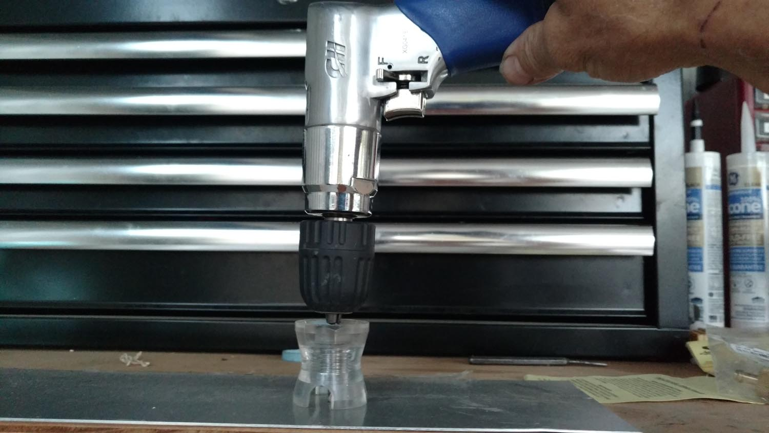 """Using a """"drill egg"""" to keep the drill bit perpendicular to the sheet."""