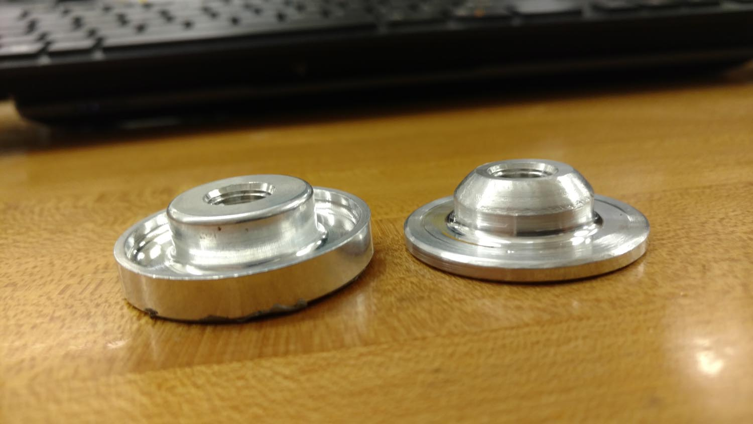 Welding flange on the right for tank vent has been modified for use with rivets.