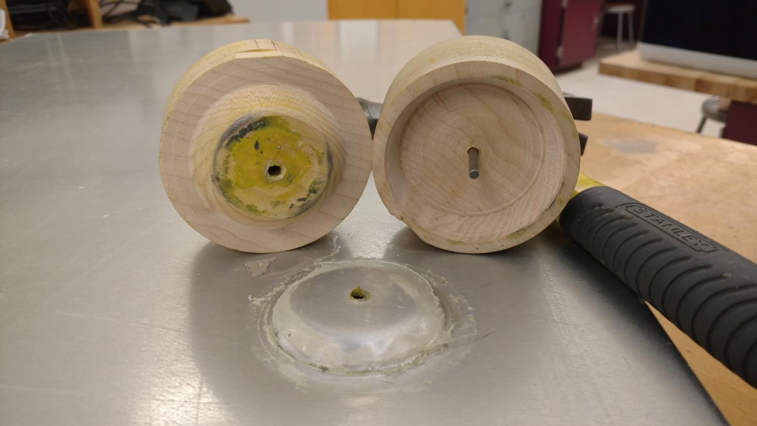 A homemade die was used to create a dimpled area that would be the lowest point in the bottom of the tank. A drain valve was added later.