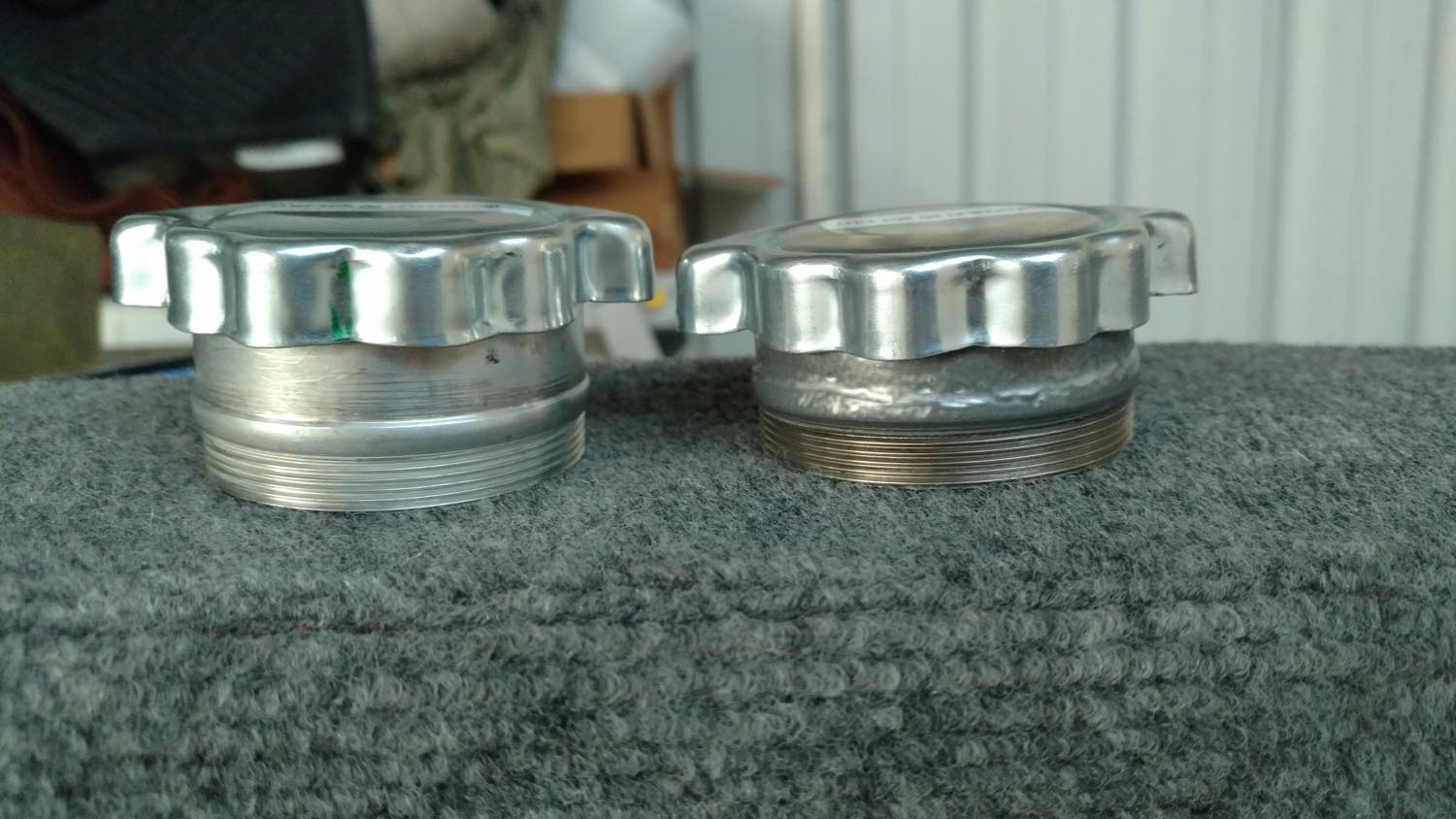 Unmodified filler neck on left, modified on right.
