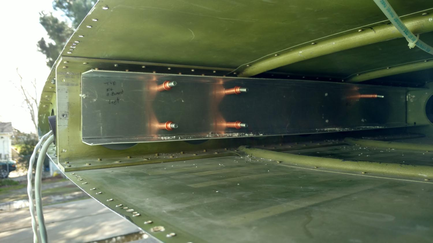 Channel that holds tanks temporarily held to the wing spar with clecos.