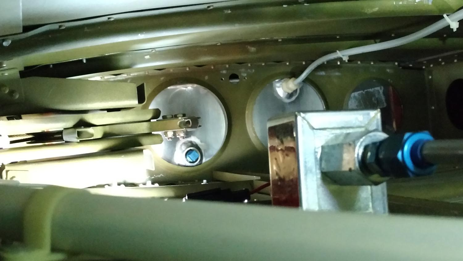 """Rectangular pump mounted inside wing. Note the 3/8"""" blue plug in the main tank where a fuel line was later plumbed."""